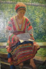 Девушка, читающая газету