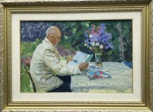 Мужчина, читающий газету