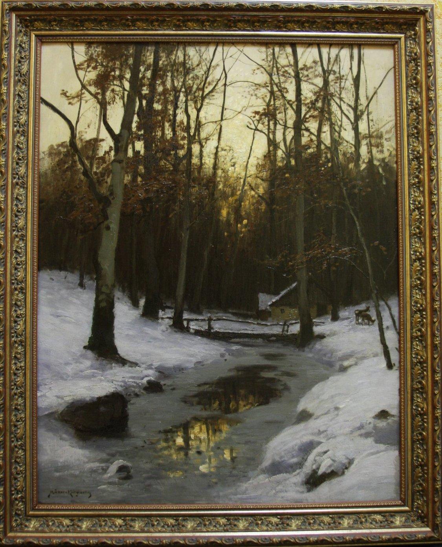 Вечернее солнце в зимнем лесу