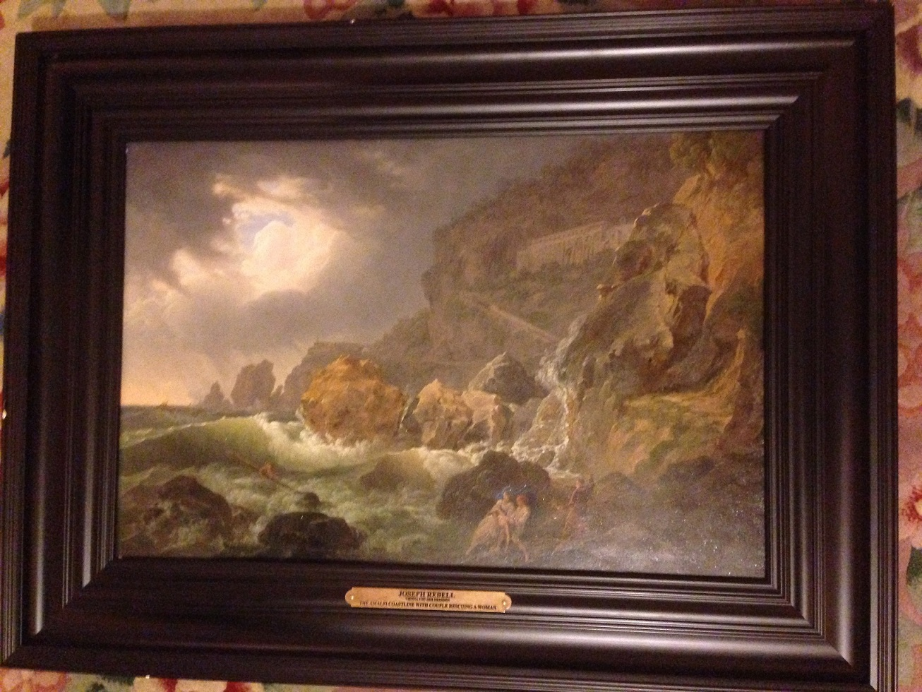THE AMALFI COASTLINE WITH THE CAPUCHIN MONASTERY IN A TEMPEST AND A COUPLE RESCUING A WOMAN FROM THE RAGING SEA