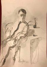 Мужчина с бутылкой на столе