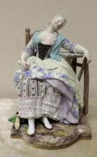 Фарфоровая статуэтка «девушка спящая в кресле»
