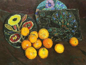Апельсины на фоне керамики
