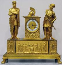 Старинные каминные часы в стиле ампир с фигурами воина и философа