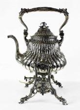 Старинный серебряный чайник (бульотка) на подставке