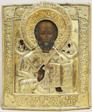Старинная икона «Николай Чудотворец» в окладе с цветочно-растительным орнаментом